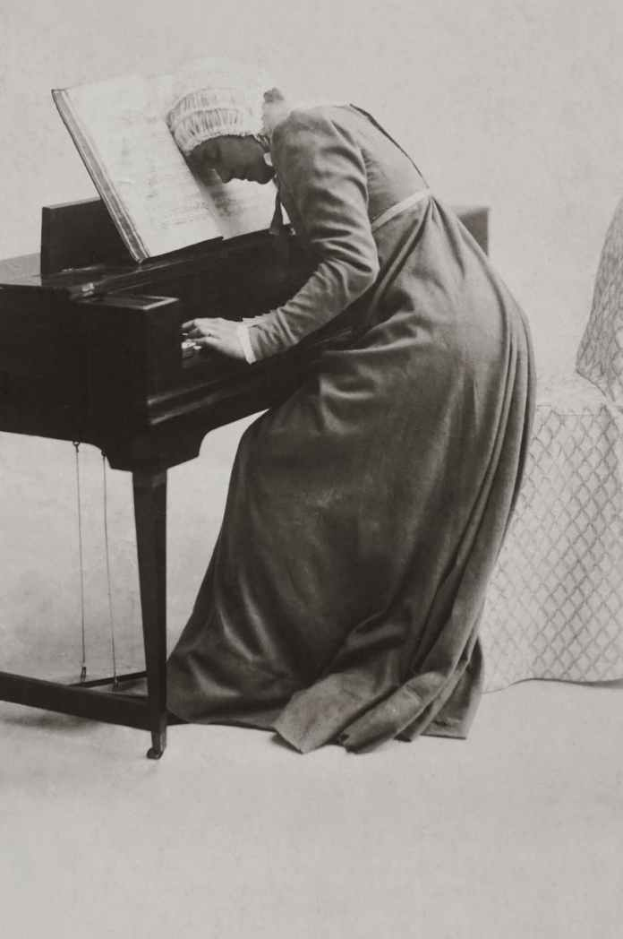 woman playing piano